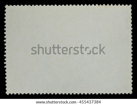 Blank postage stamp white paper on a black background - stock photo
