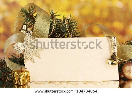 blank postcard, Christmas balls and fir-tree on yellow background - stock photo