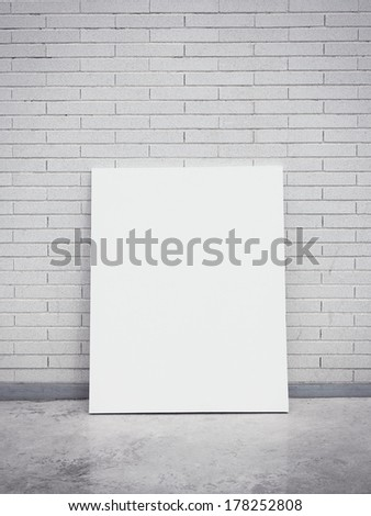 Blank poster on a brick wall - stock photo