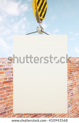 Blank poster on crane hook with clear sky and brick wall in the background. Mock up, 3D Rendering - stock photo