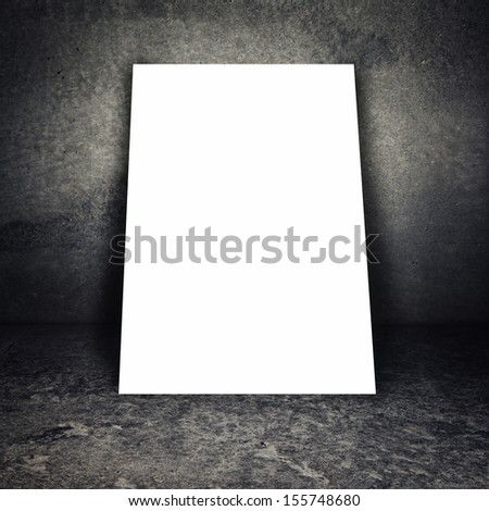Blank poster on metal chain grid fence of concrete room - stock photo