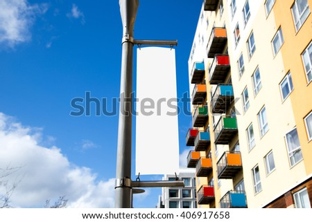 Blank poster sign with a copy space area hanged from a long pole - stock photo