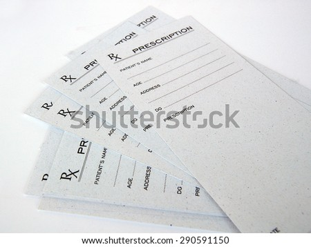Blank prescriptions over white background - stock photo