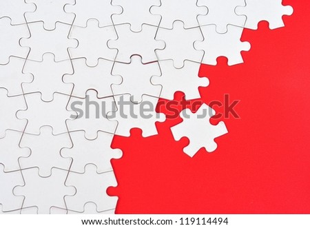 Blank puzzle on red background - stock photo