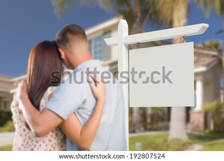 Blank Real Estate Sign and Military Couple Looking at Nice New House. - stock photo