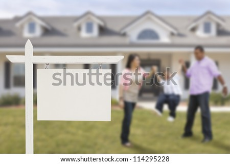 Blank Real Estate Sign and Playful Hispanic Family in Front of House. - stock photo