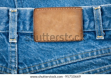 Blank real leather jeans label on a blue jeans.