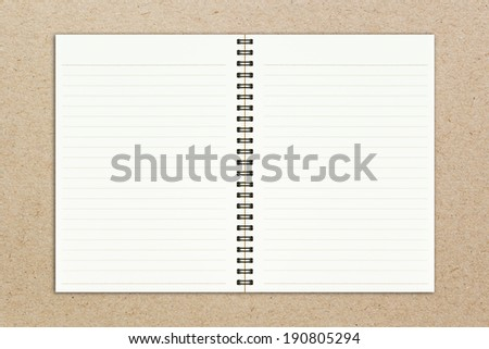 Blank realistic spiral notepad notebook on brown paper sheet background - stock photo