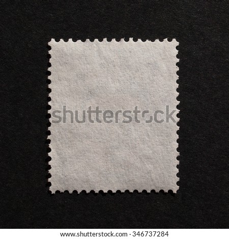 Blank rear side of a mail stamp - stock photo