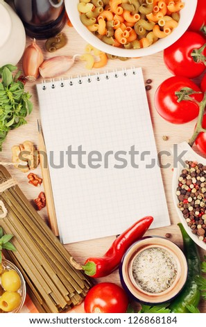 Blank recipe book on a table with vegetables  and spices - stock photo