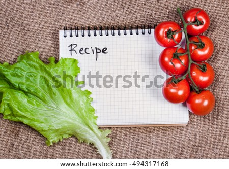 Blank recipe book on  sack cloth. Nature background