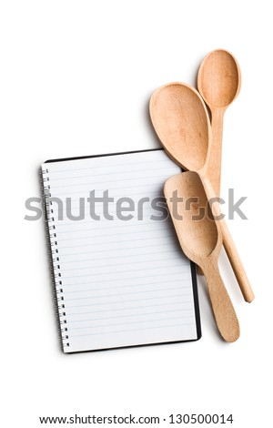 blank recipe book with kitchen utensils on white background - stock photo