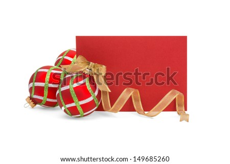 Blank red card with red, green, white Christmas balls and gold ribbon on white.  Copy space. - stock photo