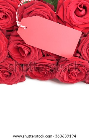 Blank red tag for your copy on red roses on white background - stock photo