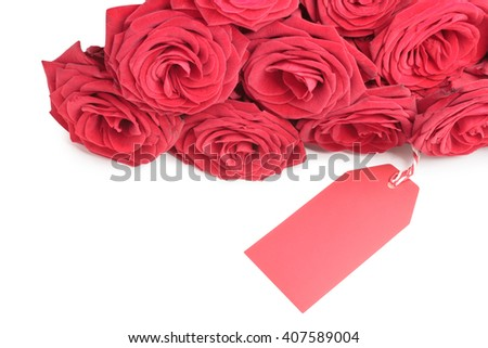 Blank red tag with red roses isolated on white background - stock photo