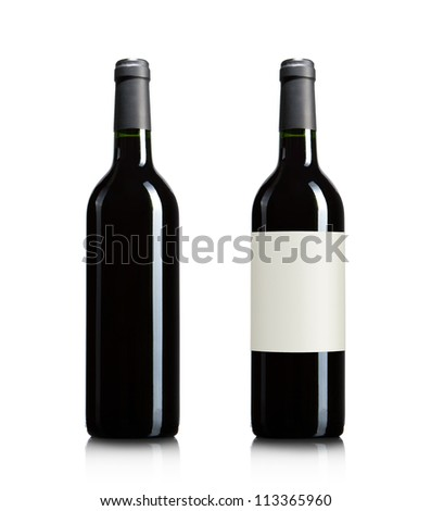 Blank red wine bottles isolated on white background with copy space - stock photo