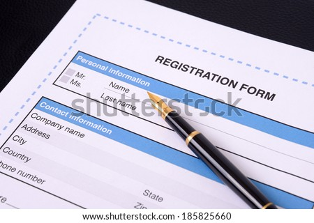 Blank registration form with a black pen.