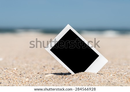 Blank Retro Instant Photo On Beach Sand In Summer - stock photo