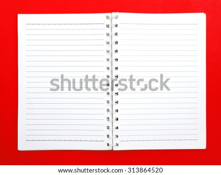 blank ring book on red background