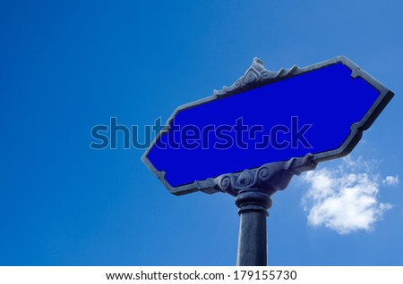 blank road sign against blue sky background