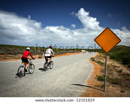 Blank road sign and bicycles - stock photo