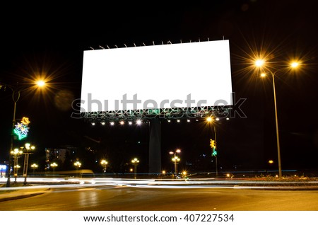 Blank roadside billboard at night in the city. - stock photo