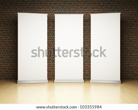 Blank roll up banner in studio on brick wall - stock photo