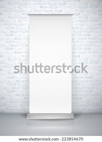 blank roll up banner isolated over brick wall - stock photo