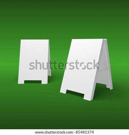 Blank sandwich board on a green background - stock photo