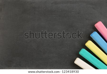Blank school board with color chalk - stock photo