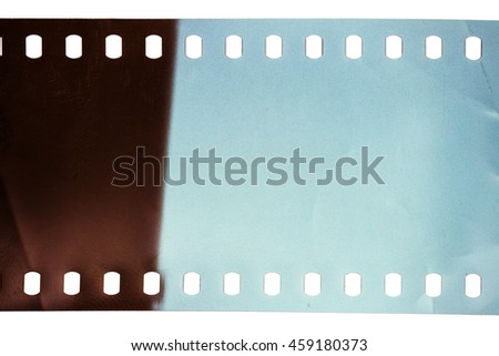 Blank scratched noisy filmstrip isolated on white background