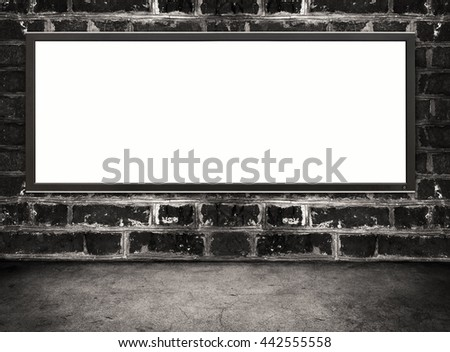 Blank screen hanging on grunge brick wall. information technology concept - stock photo