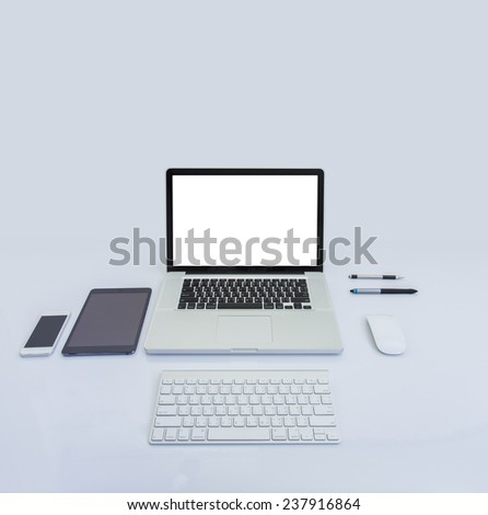 Blank screen laptop computer and accessories - stock photo