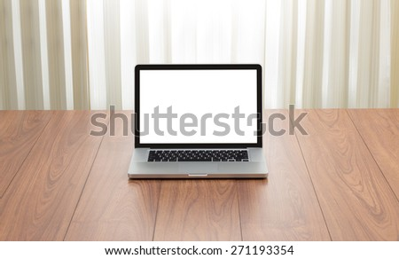 Blank screen laptop computer on wood background with window light effect - stock photo