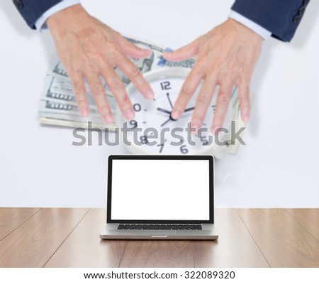 Blank screen laptop computer with financial background - stock photo