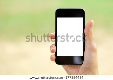 Blank screen mobile phone with woman hand - stock photo