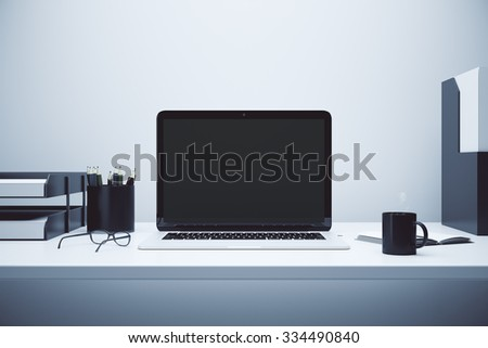 Blank screen of laptop on the table with glasses and cup of coffee, mock up 3D render - stock photo