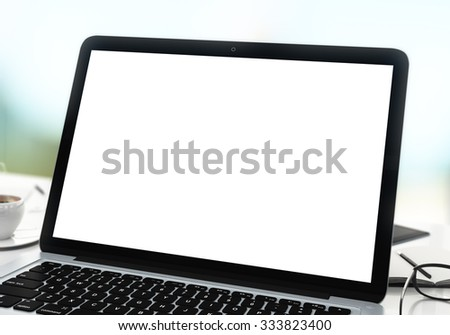Blank screen of laptop with coffee and glasses, mock up - stock photo