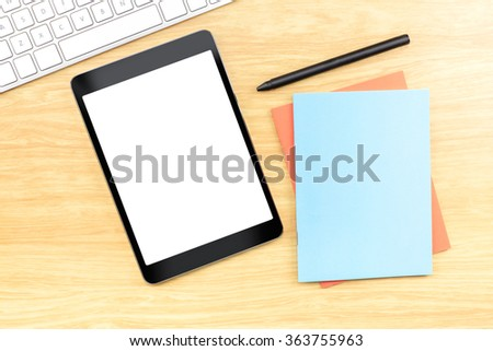 Blank screen table with blue notebook and pen at wood table, Mock up for adding your content
