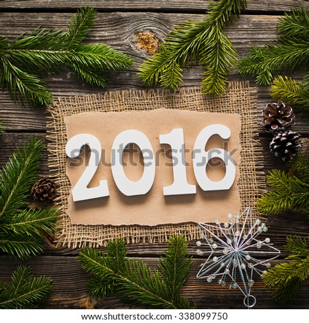 blank sheet for New Year's greetings decorated Christmas tree and pine cones - stock photo