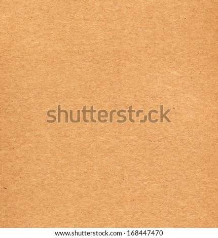 Blank sheet of brown corrugated cardboard useful as a background - stock photo