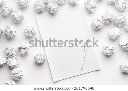 blank sheet of paper on the white table with a pen - stock photo