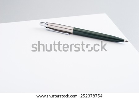 Blank sheet of paper with pen (shallow depth of field)
