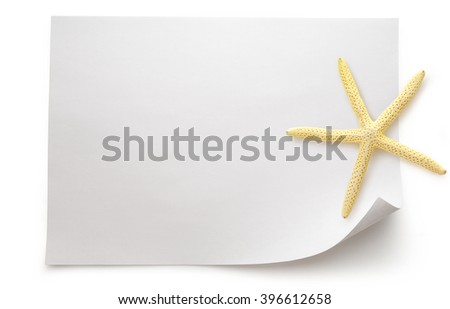 Blank sheet of paper with sea star on white background - stock photo