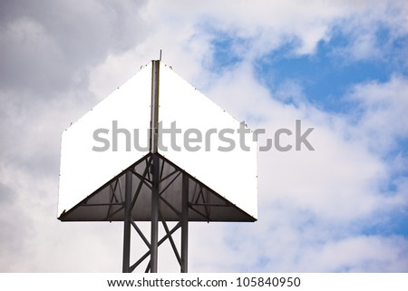 Blank sides of a triangular billboard on  blue sky with clouds - stock photo