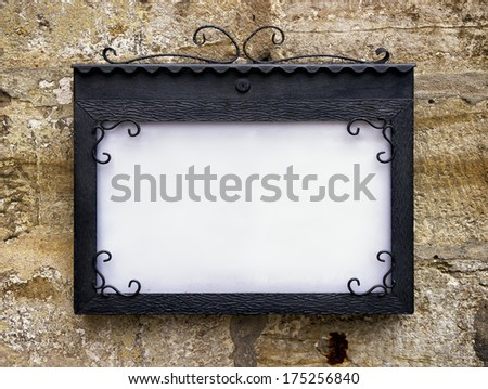 blank sign at a wall - background with space for text - stock photo