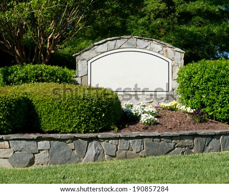 Blank sign of the subdivision entrance - stock photo