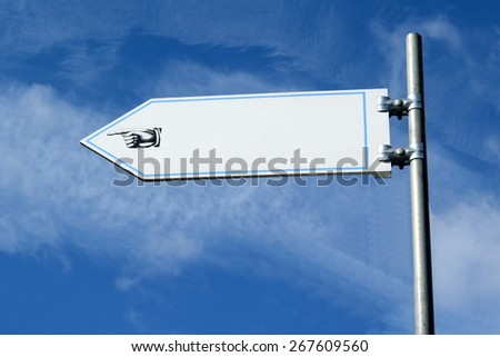 Blank  sign with hand pointing in direction - stock photo
