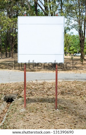 blank signboard in park - stock photo
