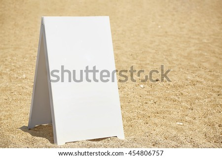 blank signboard on the beach for your message